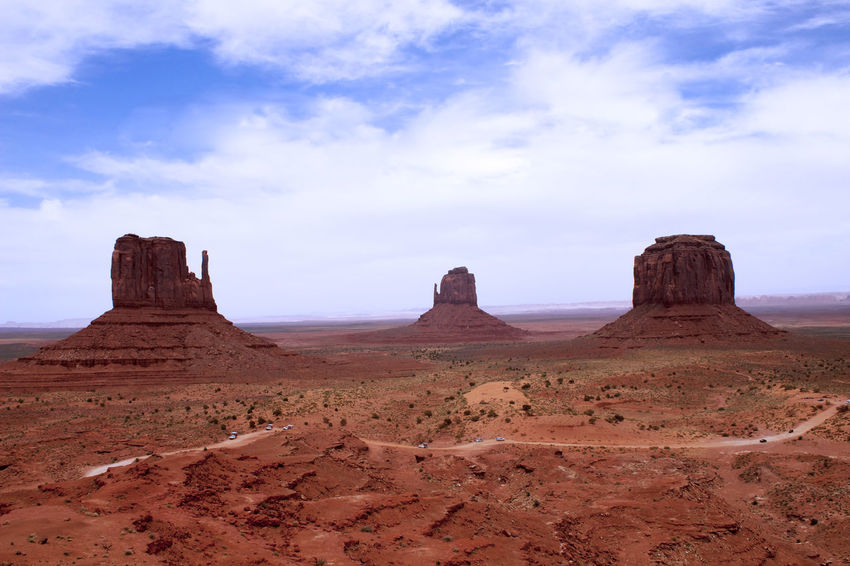 Arid Climate Beauty In Nature Brown Cloud - Sky Day Desert Geology Landscape Monument Valley Nature No People Outdoors Physical Geography Red Rock - Object Rock Formation Scenics Sky Tranquil Scene Tranquility Travel Destinations