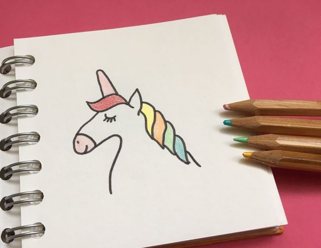 Drawing in book against pink background