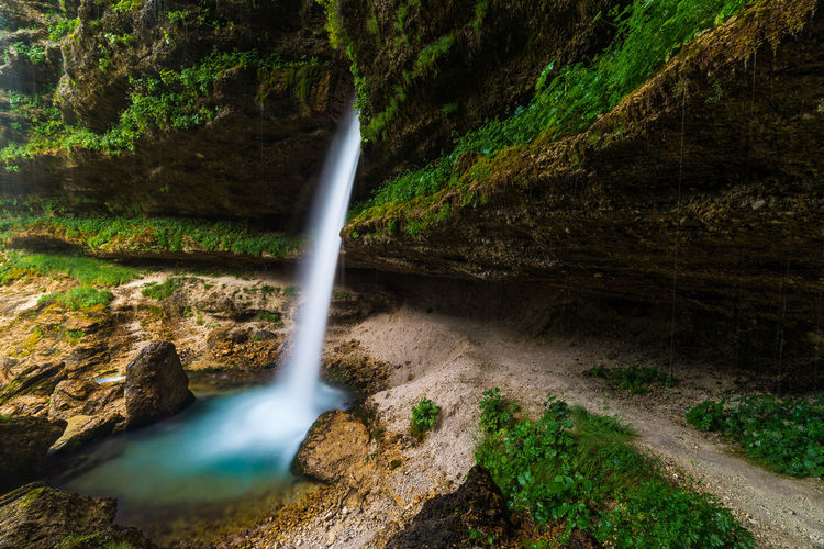 Peričnik waterfall Beauty In Nature Cave Exposure Flowing Water Foliage Idyllic Landscape Long Motion Nature Nature Outdoors Photography Rock Rock Formation Scenics Slovenia Stream Tranquility Water Waterfall