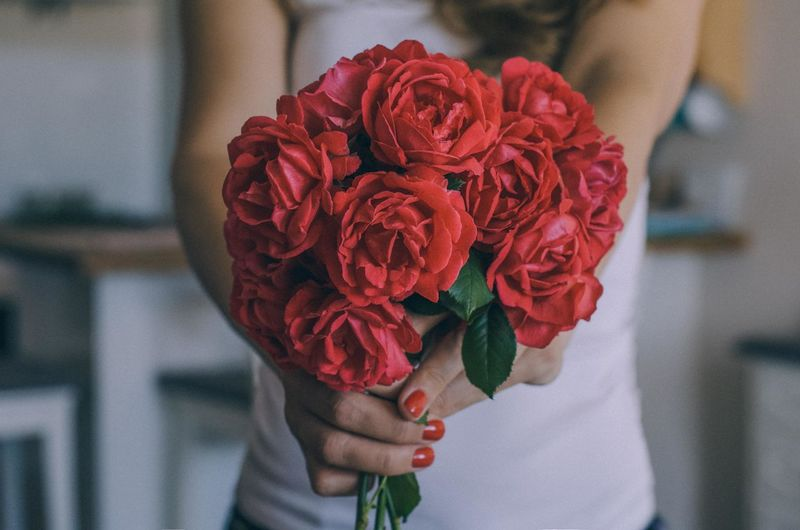 Beauty In Nature Bouquet Bunch Of Flowers Close-up Finger Flower Flower Arrangement Flower Head Flowering Plant Focus On Foreground Fragility Freshness Hand Holding Human Hand Inflorescence Midsection One Person Petal Plant Real People Red Rosé Rose - Flower Vulnerability