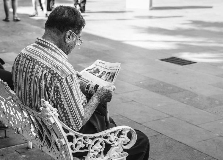 Art Black And White Black And White Collection  Candid Candid Photography Casual Clothing Charming Day Documentary Focus On Foreground Leisure Activity Lifestyles Mexico News Newspaper Outdoors People Watching Street Streetphotography Town Travel Travel Photography Urban Urban Geometry