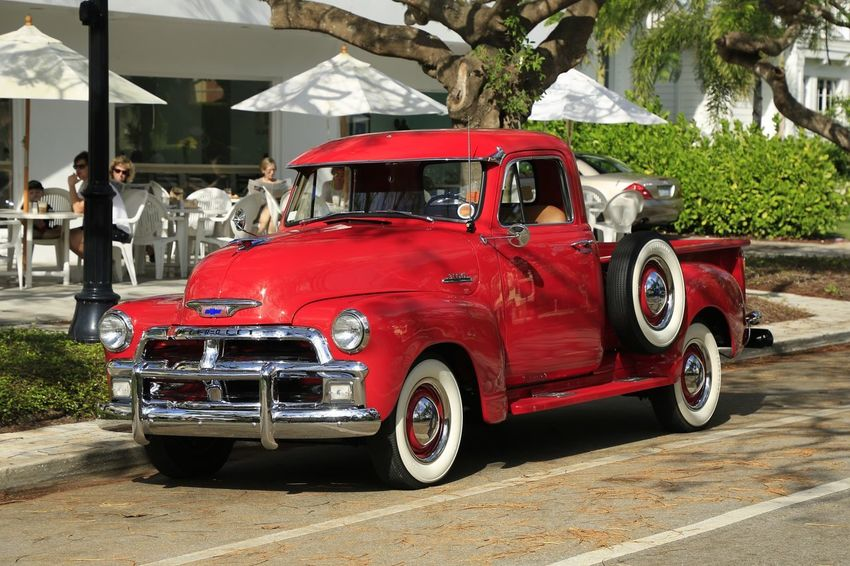 A ride for all occasions Antique Truck Classic Truck Mode Of Transport Country Life Antique Car Classic Car Historic Vehicle Red Outdoors Day City People Adult