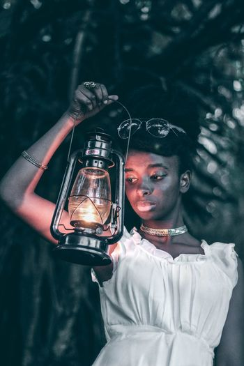 Lantern Photos Official EyeEm © Lantern Tree Nature Youth Culture Outdoors Standing Canon Camera The Week On EyeEm Africa EyeEm Market 2017 Close-up Fresh on Market 2017 Framing The Subject Teenagers  EyeEm Gallery