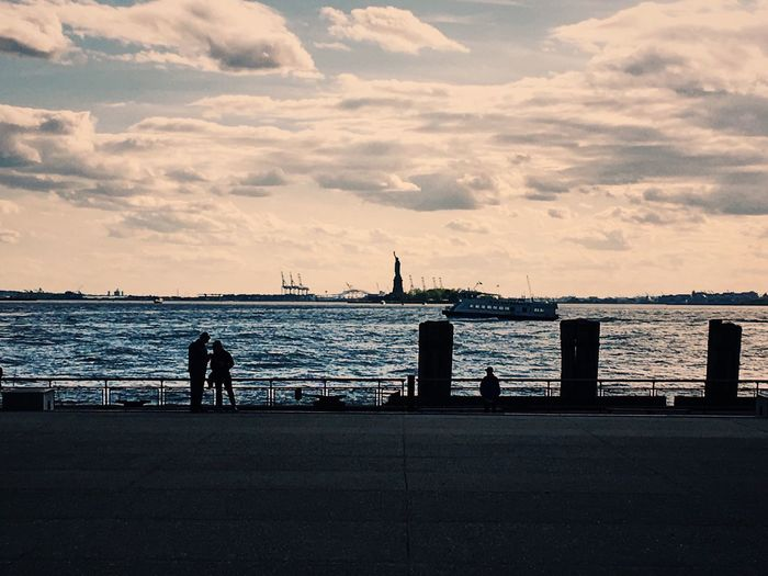 Sea Water Silhouette Sky Cloud - Sky Horizon Over Water Nature Built Structure Beach Architecture Outdoors Beauty In Nature Sunset Day One Person City People New York City Statue Of Liberty