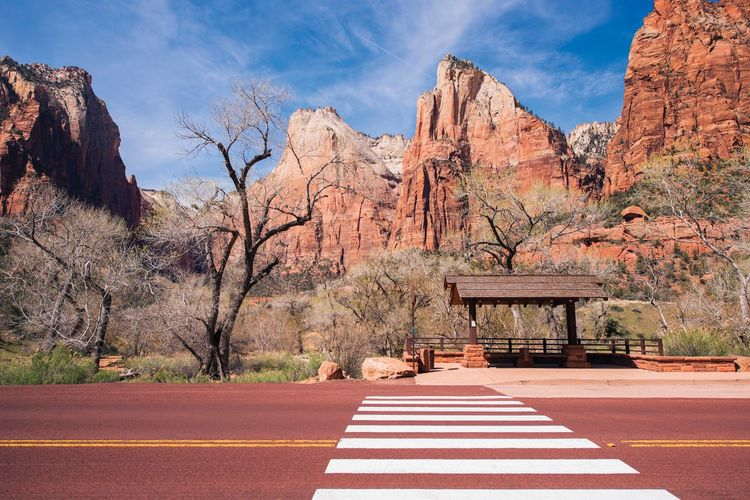 Zebra Crossing On Road Against Mountains