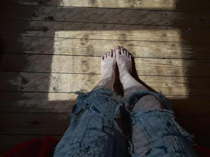Low section of woman on hardwood flooring