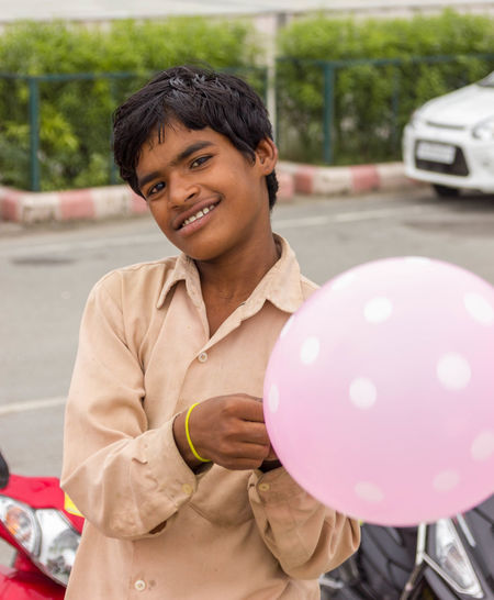 Portrait of happy boy with balloons