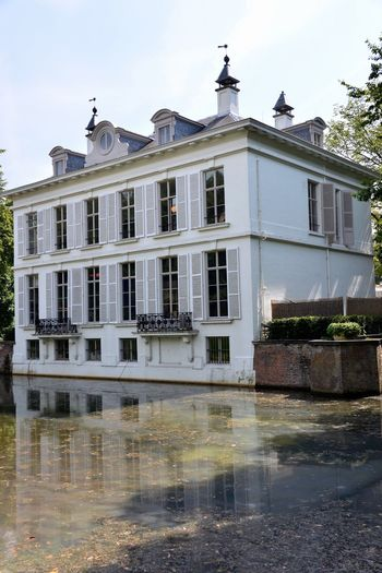 Architecture Built Structure Building Exterior Water Reflection Waterfront Outdoors No People Façade House Small Castle Old Architecture Beauty In Nature Façade Architecture Old Building  Old Building Exterior White House Middelheim Park Middelheim