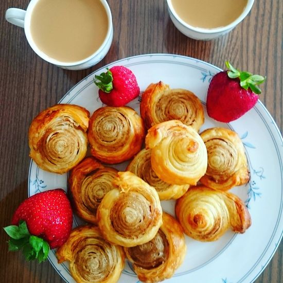 Fresh bunny with cinnamon Cinamon Morning Breakfast Pastry Drink Fruit Dessert Plate French Food Directly Above Table Strawberry High Angle View Close-up Sweet Pie Dessert Topping Sponge Cake Unhealthy Lifestyle Puff Pastry Fruitcake Whipped