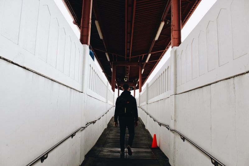 San Jose Train Architecture Built Structure Real People Full Length Men Lifestyles The Architect - 2018 EyeEm Awards Direction The Way Forward Day Rear View Transportation Walking Standing Wall - Building Feature Leisure Activity Outdoors Building