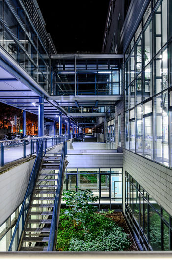 Architecture Built Structure Modern Railing Transportation Illuminated Building Exterior Glass - Material City No People Connection Building Staircase Motion Outdoors Rail Transportation Public Transportation Railroad Station Escalator