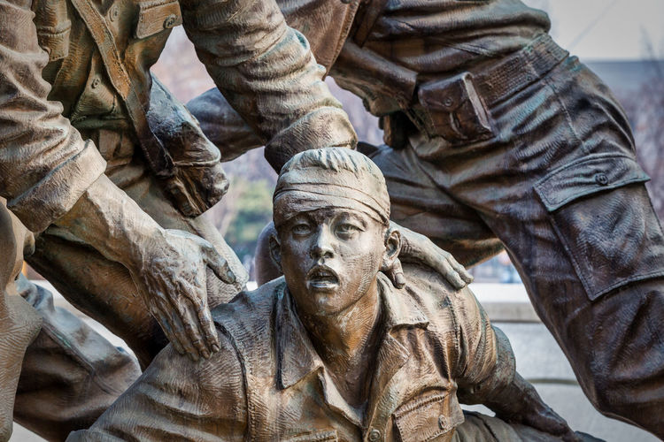 A memorial statue at the Korean War Memorial in Seoul, South Korea. EyEmNewHere Memorial War Memorial Army Soldier Close-up Day Human Representation Male Likeness Military Monument Outdoors Sculpture Statue