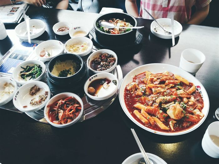 High Angle View Of Korean Food Served On Restaurant Table