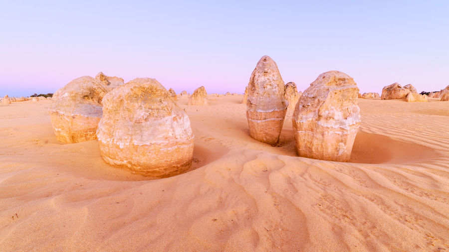 Land Sand Rock Scenics - Nature Tranquil Scene Clear Sky Rock Formation Tranquility Rock - Object Beauty In Nature Desert Nature Solid Non-urban Scene Geology No People Landscape Arid Climate Eroded Australia Travel Destinations Travel Sunset Colorful Pinnacles