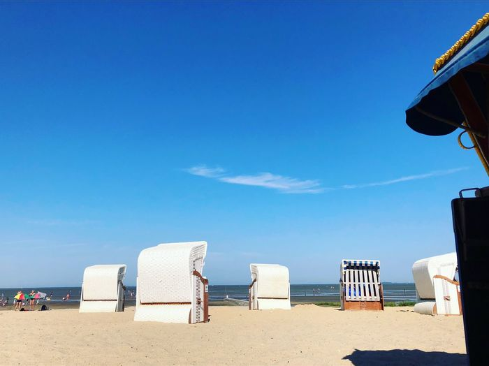 • On the beach • Bluesky Strandkorb Cuxhaven Northsea Sky Beach Land Blue Water Nature Sand Sea Day Sunlight Holiday Vacations Beauty In Nature Hooded Beach Chair Scenics - Nature Horizon Over Water Tranquility Outdoors