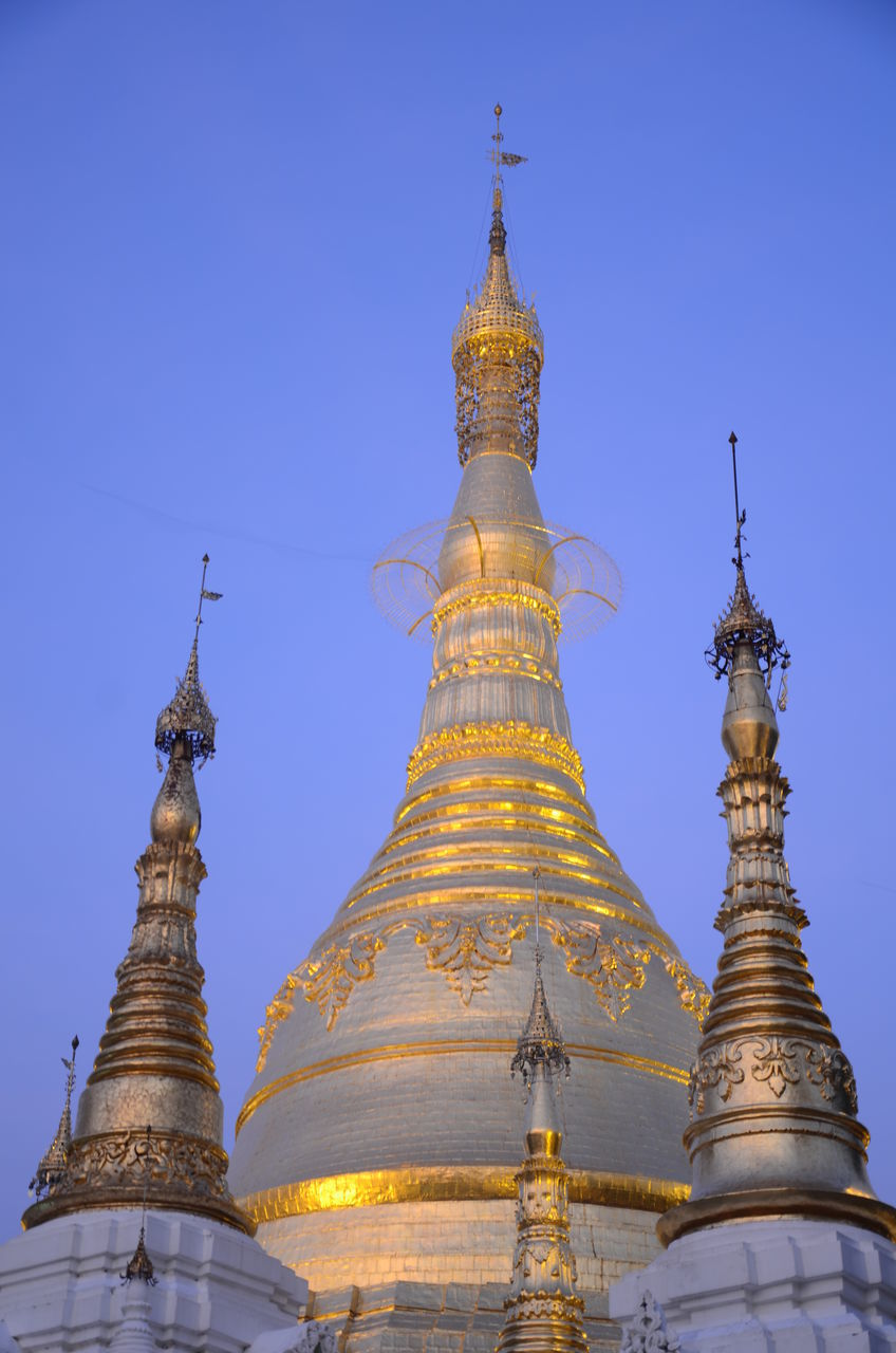 religion, place of worship, spirituality, architecture, gold colored, built structure, pagoda, building exterior, clear sky, travel destinations, low angle view, no people, outdoors, dome, day, sky