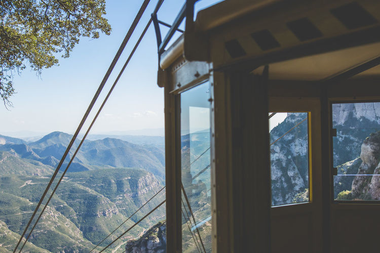 Overhead cable car station against mountains