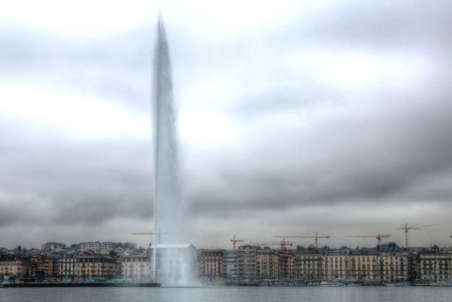 Geneva Switzerland Water Jet Water Spraying Architecture Motion Built Structure Storm Long Exposure Outdoors Cityscape Building Exterior Storm Cloud No People City Cloud - Sky Power In Nature Extreme Weather Skyscraper Urban Skyline Day Sky