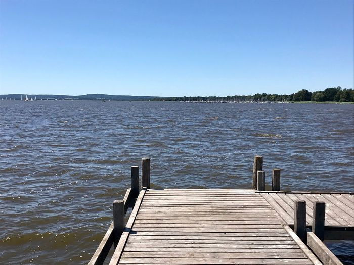 Steinhuder Meer Travel Destinations Steinhude-am-meer.de - Dein Meer-Foto Steinhuder Meer Water Sky Clear Sky Pier Tranquility Beauty In Nature Wood - Material No People Lake Blue Scenics - Nature Nature Outdoors