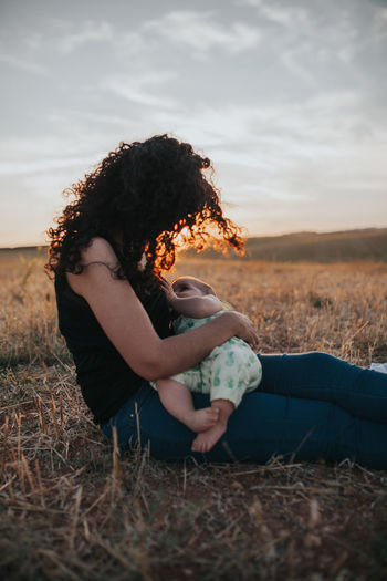 Baby Family Family Matters Family❤ Mother Mother & Daughter Mother And Son Motherhood Baby Feeding Bonding Cloud - Sky Family Bonds Family Time Family With One Child Field Full Length Hairstyle Land Side View Sitting Sky Sunset Women