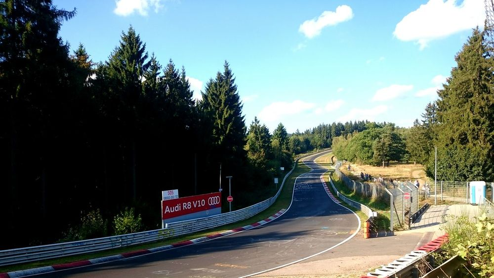 Tree Road Sky Cloud Blue Curve Outdoors Day The Way Forward Transportation Country Road Green Solitude Long Cloud - Sky Nürburgring Racetrack Nurburgring Race Racetrack Beauty In Nature