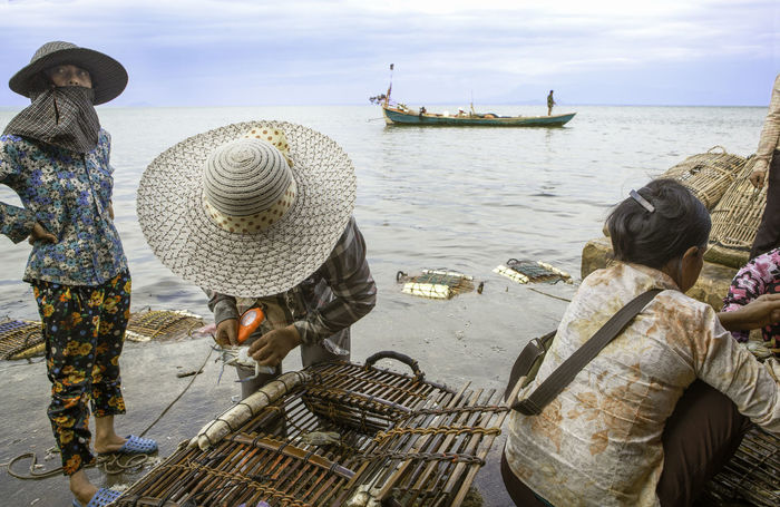 Crab fisherwomen in Kep, Cambodia Cambodia Crab Gulf Of Thailand Worker Workers Adult Adults Only Asian Style Conical Hat Crab Fishermen Crab Fishing Day Fishing Kep Nature Occupation Outdoors People Real People Rear View Sea Standing Water Women Working