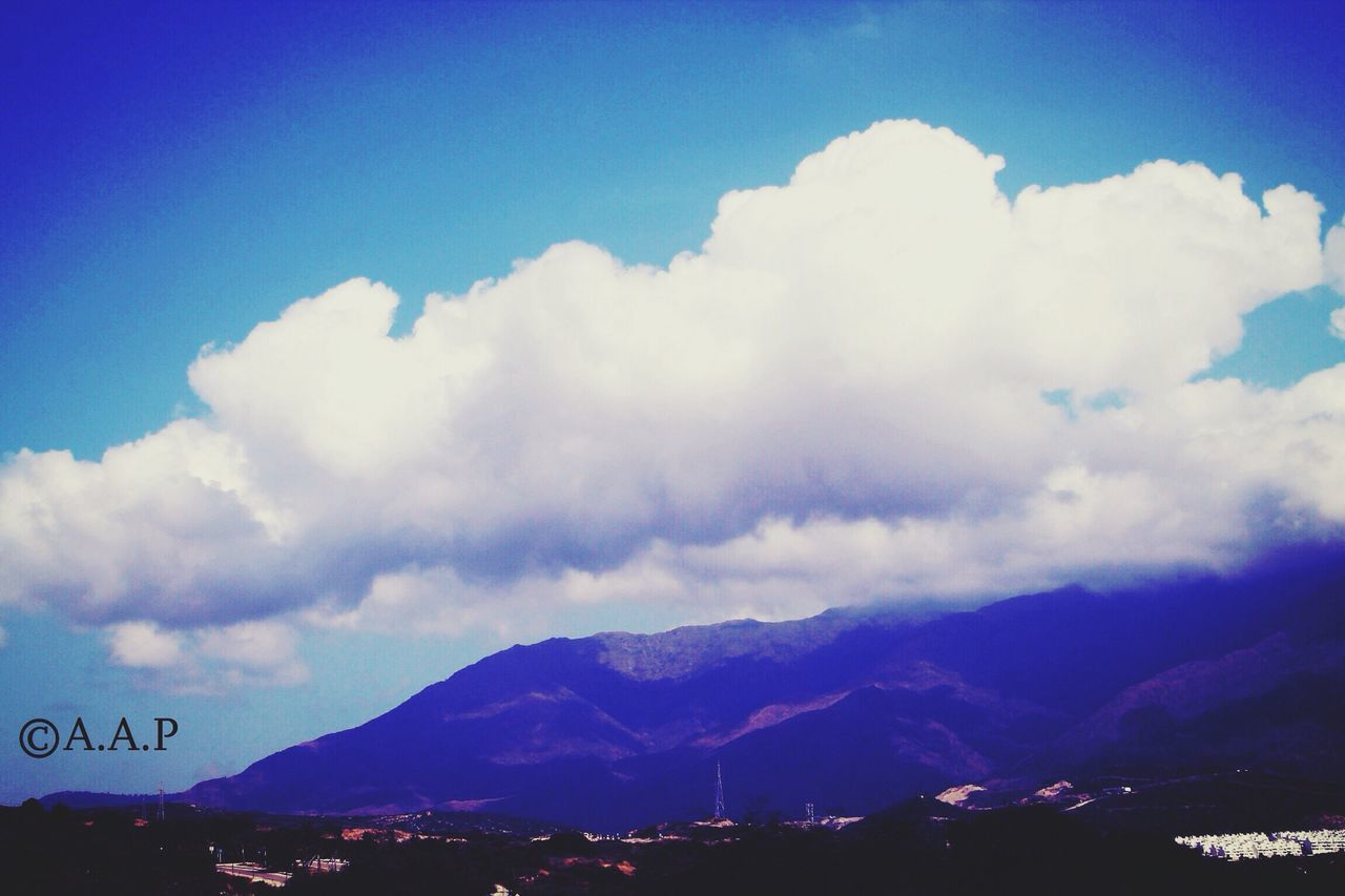 cloud - sky, sky, mountain, scenics, beauty in nature, nature, tranquility, outdoors, no people, mountain range, tranquil scene, blue, day, landscape
