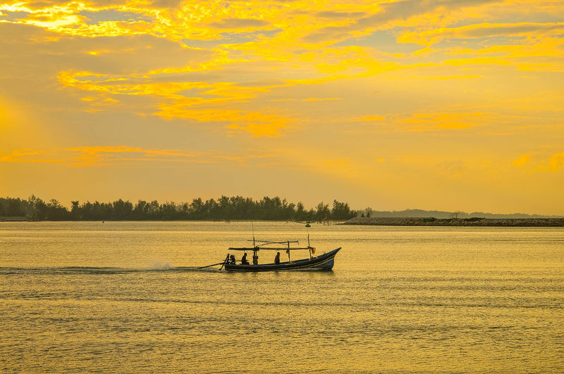 Last Light Of Fishing Boat At Songkhla Port Thailand Beauty In Nature Cloud - Sky Idyllic Mode Of Transportation Nature Nautical Vessel No People Non-urban Scene Orange Color Outdoors Scenics - Nature Sea Sky Sunset Tranquil Scene Tranquility Transportation Water Waterfront Yellow