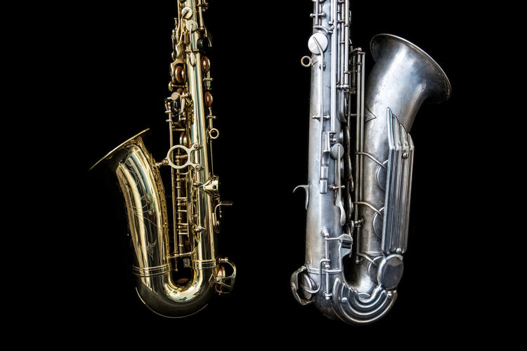 Two saxophones isolated in black. Music Arts Culture And Entertainment Black Background Brass Brass Instrument  Close-up Gold Colored Indoors  Jazz Music Metal Music Musical Equipment Musical Instrument No People Saxophone Silver Colored Still Life Studio Shot Two Objects Wind Instrument Wind Instruments