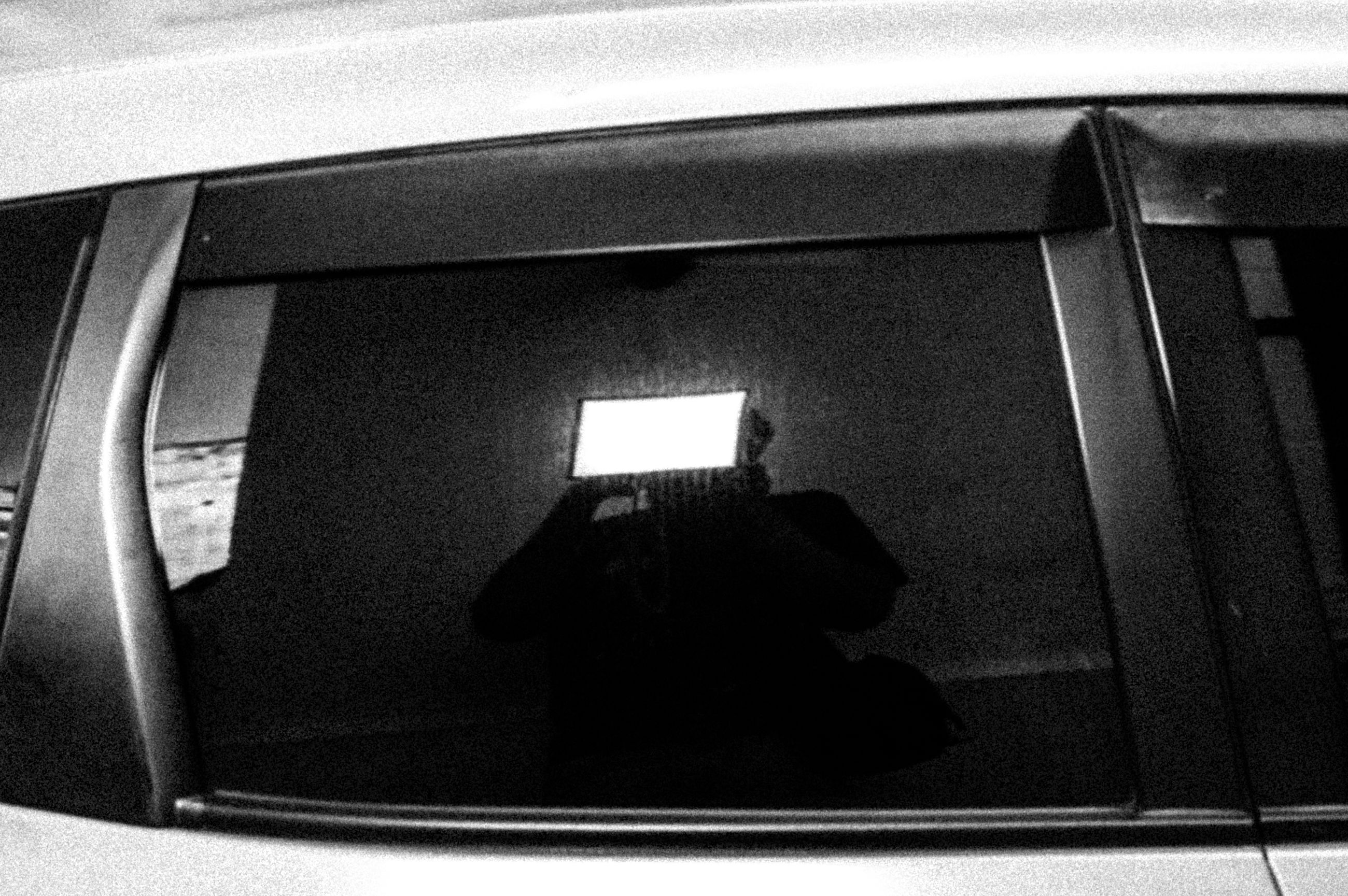 real people, rear view, photographing, technology, illuminated, one person, men, transportation, indoors, lifestyles, day, photography themes, wireless technology, people