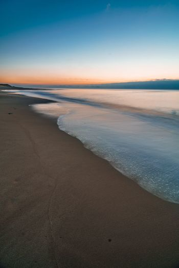 Cold silent sunset Long Exposure List Sylt_collection Sylt Strand EyeEm Selects Beach Sea Sand Scenics Beauty In Nature Tranquility Tranquil Scene Nature Water Sunset Horizon Over Water Outdoors No People Sky Wave