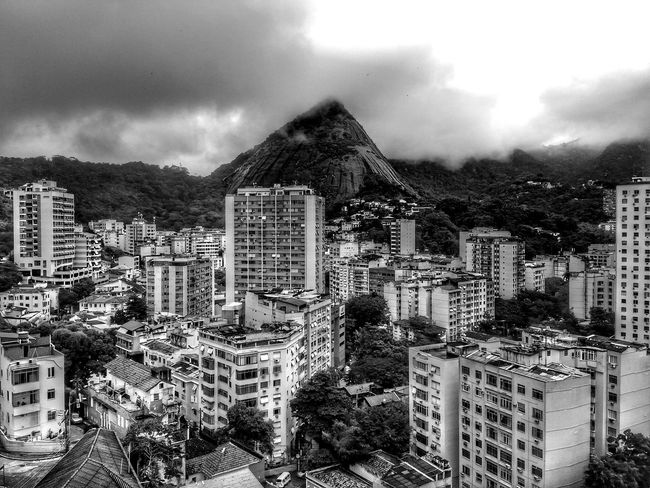 Cityscape with buildings and mountains. Cloud - Sky Mountain Cityscape Outdoors Skyscraper No People City Capital Cities  Brazilian Forest Hillside Tropical Black And White Blackandwhite Monochrome Urban Skyline Storm Cloud Landscape High Angle View Scenics Residential Building Mountain Range Ecology Nature Meets Urban Living With Nature