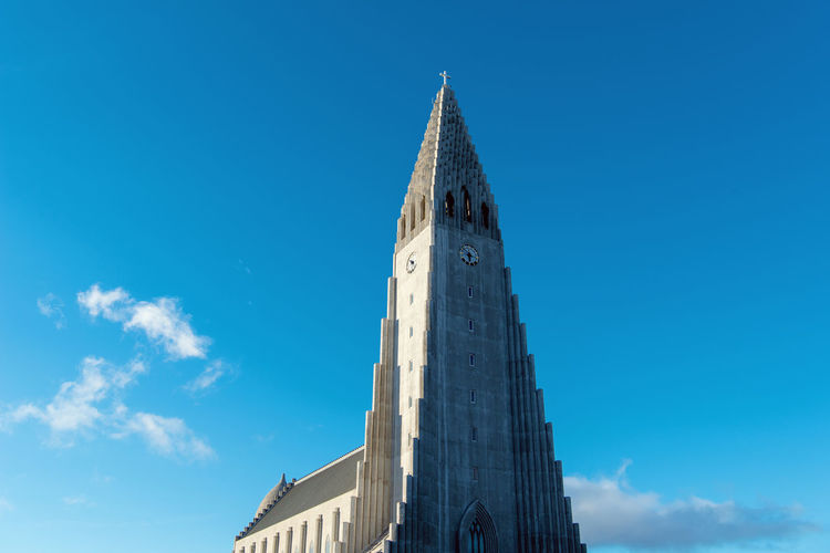 Hallgrímskirkja is a Lutheran parish church in Reykjavík, Iceland. Built Structure Sky Architecture Building Exterior Blue Building Low Angle View Tower Nature Place Of Worship Religion Belief No People Day Tall - High Spirituality History Copy Space The Past Clock Spire  Church Architecture Iceland Hallgrìmskirkja