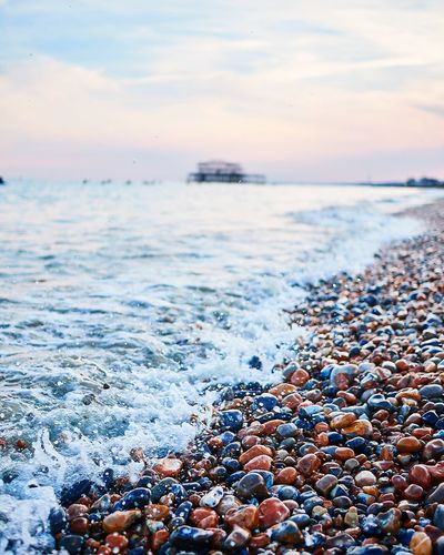 Sandless beach Brighton Pier Brighton Beach England, UK England 🇬🇧 Water Pebble Beach Sea Sunset Beach Wave Blue Pebble Sky Close-up Dramatic Sky Coast Romantic Sky Atmospheric Mood Atmosphere Low Tide Seascape First Eyeem Photo