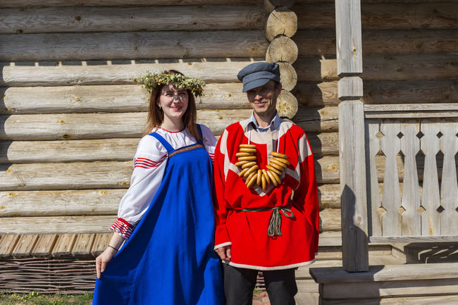 Photo of a couple in a Russian national costume. Summer Summertime Young Girl Young National Costume National Clothes National Dress Wreath Circlet Of Flowers Russian Girl Russian Clothes Russian Dress Outdoors Outdoor Photography Couple Couple - Relationship Couples Shoot Two People Clothing People Day