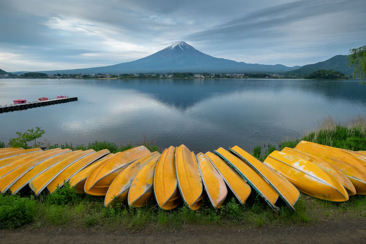 Mountain fuji and lake kawaguchi, Japan Japan Kawaguchiko Beauty In Nature Blue Boat Cloud - Sky Day Idyllic Lake Mountain Nature Nautical Vessel No People Non-urban Scene Outdoors Plant Reflection Rowboat Scenics - Nature Sky Snow Tranquil Scene Tranquility Transportation Water