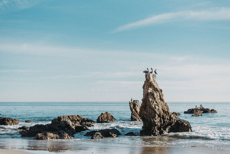Calm Sky And Clouds Tranquility Beach Beauty In Nature Cloud - Sky Day Horizon Horizon Over Water Land Nature No People Ocean Outdoors Rock Rock - Object Scenics Scenics - Nature Sea Sky Stack Rock Tranquil Scene Tranquility Water Waterfront