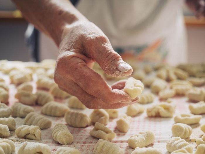 Human Hand Hand One Person Human Body Part Food And Drink Preparation  Food Indoors  Freshness Dough Preparing Food Real People Close-up Domestic Room Making Pasta Midsection Selective Focus Occupation Chef Finger Senior Women Italian Food