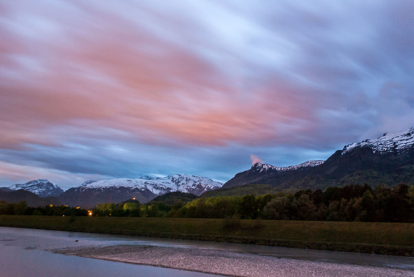 The evening mood during the blue hour in Vaduz Liechtenstein with the view of the panoramic mountains Beauty In Nature Blue Hour Clouds Clouds And Sky Europe Landscape Liechtenstein Liechtenstein Mountains Longtimeexposure Mountain Mountain Range Nature Nature Outdoors Scenics Sky Tranquility Travel Travel Destinations Vaduz