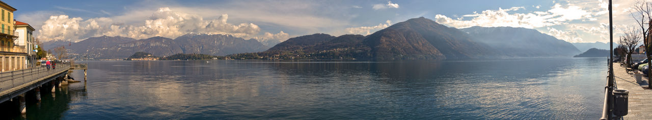 bellaggio on the como lake Coastline Como Lake Nature Panoramic View Sky And Clouds Snow Capped Mountains Tourist Attraction  Tranquility Winter Beauty In Nature Bellaggio Clouds Horizon Italy Lago Di Como Landscape Landscapes Lombardia Sunny Day Sunset Tourist Destination Water
