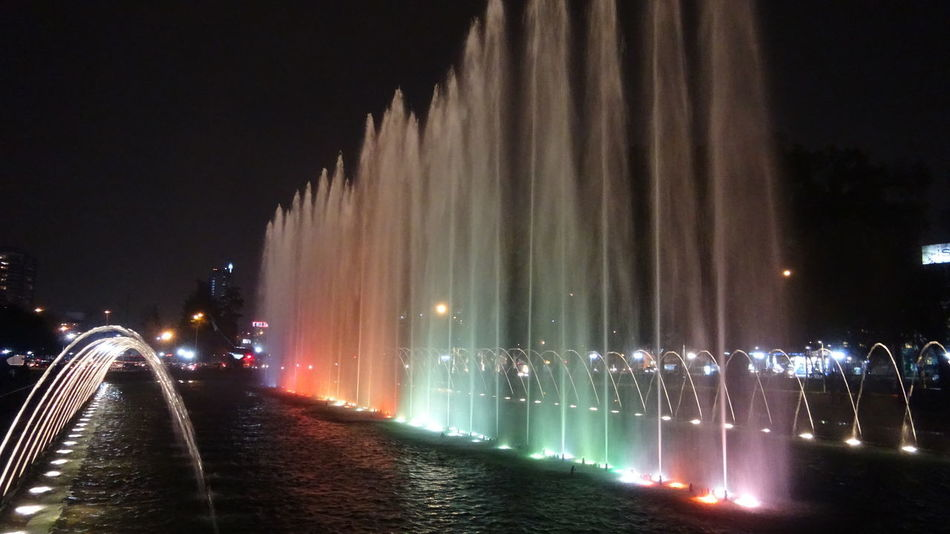 Fountain and city lights Fountain Fountain Lights Lights City Lights Cityscapes Fountain Show Sunset Water