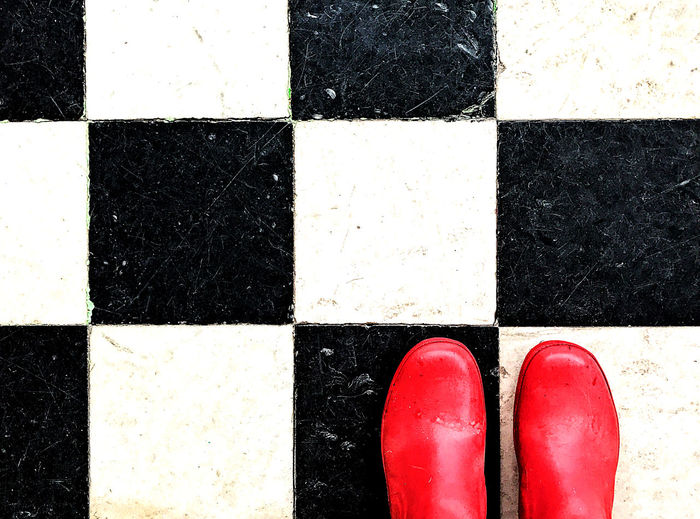 High angle view of shoes on tiled floor