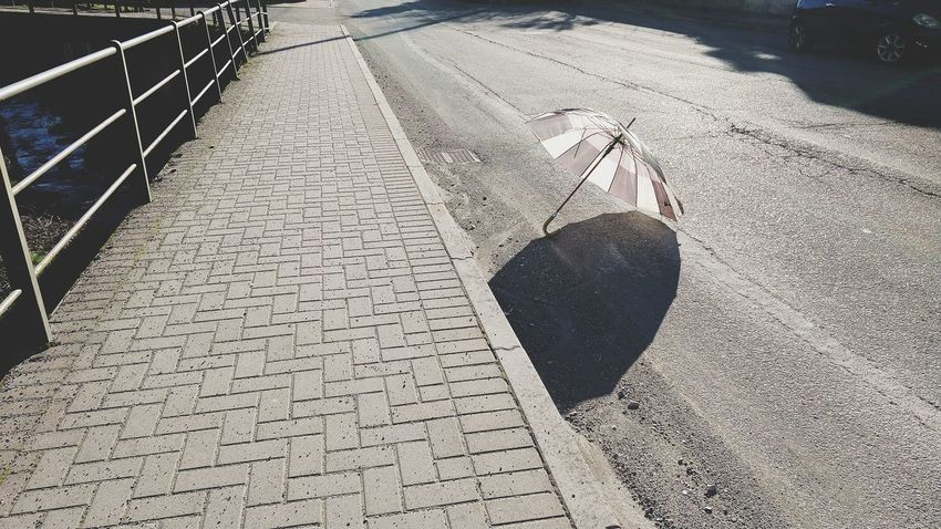 The unpredictable. Umbrella On The Road Objects Objects Of Interest Point Of View Perspectives Shadow Sunlight Close-up