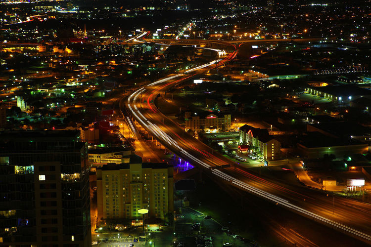 Aerial of San Antonio expressways at night Aerial Architecture Building Exterior Built Structure City City Life City Street Cityscape Cityscape High Angle View Highway Illuminated Light Trail Long Exposure Motion Night On The Move Road San Antonio Speed Street Texas Traffic Transportation