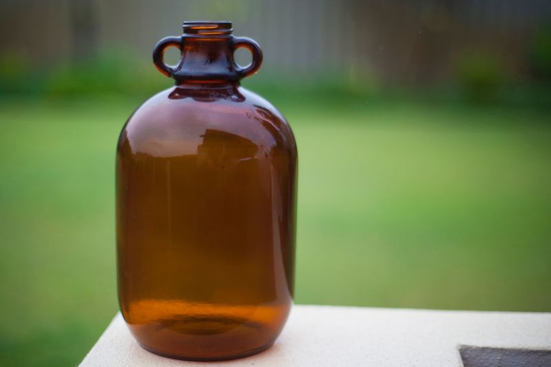 Wet bottle Half Gallon Western Australia Bottle Container Food And Drink Refreshment Drink Focus On Foreground Still Life No People Close-up Table Glass - Material Freshness Day Single Object Household Equipment Indoors  Transparent Glass Food Brown