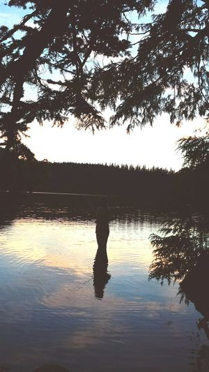 Fishing at dusk. Fishing Lake Dusk
