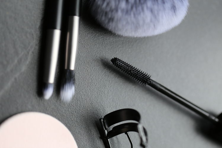 Black Color High Angle View Indoors  Close-up Still Life Table Headphones Make-up Technology Fashion Arts Culture And Entertainment Music Body Care Connection Human Body Part People Pen Beauty Body Care And Beauty