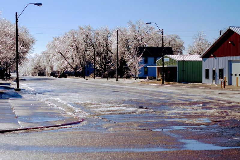 """Visual Journal January 17, 2017 Western, Nebraska - 15 and 16 January 2017 Ice Storm - Over the course of 15 and 16 January 2017, an upper-level storm system tracked from northwest Mexico into the central Plains. A seasonably moist low-level air mass present ahead of the upper-air disturbance surged north through the Great Plains, atop a sub-freezing, near-surface layer of air. The net result was a widespread ice storm which affected locations from the southern High Plains into the mid Missouri River Valley. This winter storm was unusual from the perspective that the predominant precipitation type was freezing rain with little in the way of observed snowfall. Over eastern Nebraska and southwest Iowa, ice accumulations ranged from 0.50-0.75"""" across southeast Nebraska to 0.10-0.20"""" in the Omaha Metro area. Building Exterior Camera Work Canon FD 50mm F/1.8 Cold Temperature Extreme Weather Eye 4 Photography EyeEm Gallery FUJIFILM X-T1 Ice Storm Icy Day Manual Focus My Neighborhood Nebraska Weather No People Outdoors Photo Diary Photo Essay Photography Rural America Small Town Stories Storytelling Visual Journal Winter Winter Winter Wonderland"""