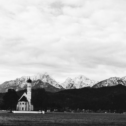 Church in front of the Bavarian alps at Hohenschwangau / Neuschwanstein Architecture Bavaria Bavarian Alps Bavarian Landscape Beauty In Nature Blackandwhite Bw Cloud - Sky Day Hohenschwangau Landscape Monochrome Mountain Nature Neuschwanstein NeuschwansteinCastle No People Outdoors Sky