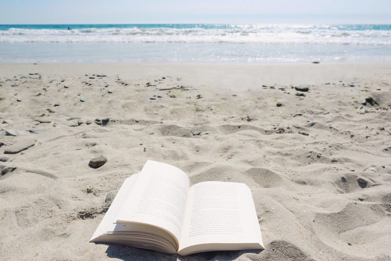 Reading Absence Beach Beauty In Nature Book Day Education Horizon Horizon Over Water Land Nature No People Outdoors Publication Reading A Book Sand Scenics - Nature Sea Sky Tranquil Scene Tranquility Water